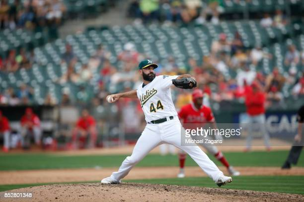 Chris Hatcher of the Oakland Athletics pitches during the game against the Los Angeles Angels of Anaheim at the Oakland Alameda Coliseum on September...