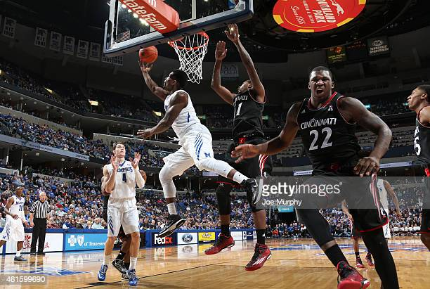 Chris Hawkins of the Memphis Tigers shoots a reverse layup against Gary Clark as Coreontae DeBerry of the Cincinnati Bearcats reacts on January 15,...