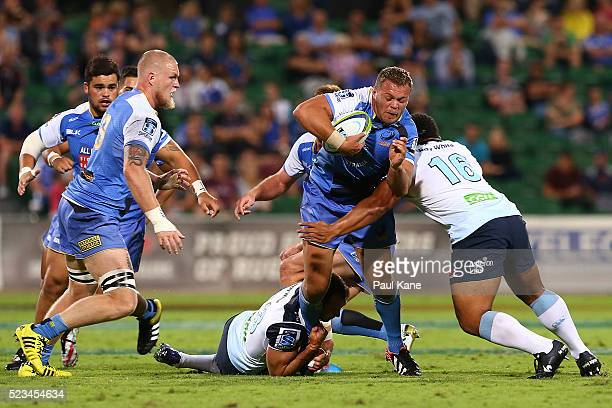 Chris Heiberg of the Force gets tackled by Tatafu PolotaNau and Matt Carraro of the Waratahs during the round nine Super Rugby match between the...