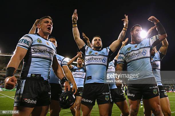 Chris Heighington Jack Bird and Andrew Fifita of the Sharks celebrate victory with their team mates during the NRL Qualifying Final match between the...