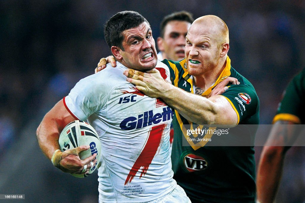 Chris Heighington of England is grabbed round the throat by Keith Galloway of Australia during the international rugby league match England v Australia at Wembley Stadium, London on November 5th 2011 (Photo by Tom Jenkins/Getty Images). An image from the book 'In The Moment' published June 2012