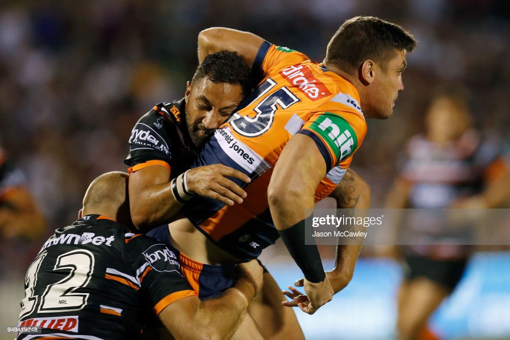 Chris Heighington of the Knights is tackled by Benji Marshall of the Knights during the round seven NRL match between the Wests Tigers and the Newcastle Knights at Scully Park on April 21, 2018 in Tamworth, Australia.