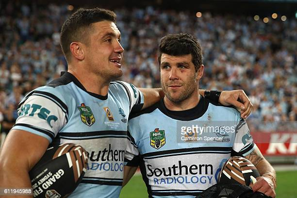 Chris Heighington of the Sharks and Michael Ennis of the Sharks embrace after winning the 2016 NRL Grand Final match between the Cronulla Sharks and...