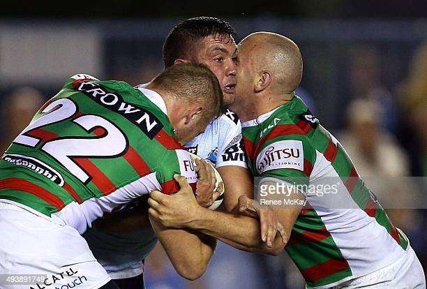 Chris Heighington of the Sharks is tackled by the Souths defence during the round 11 NRL match between the Cronulla-Sutherland Sharks and the South...