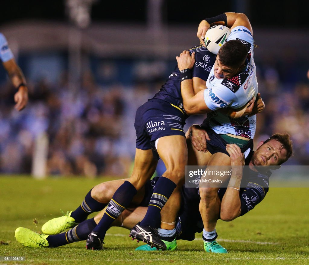 Chris Heighington of the Sharks is tackled during the round 11 NRL match between the Cronulla Sharks and the North Queensland Cowboys at Southern Cross Group Stadium on May 18, 2017 in Sydney, Australia.