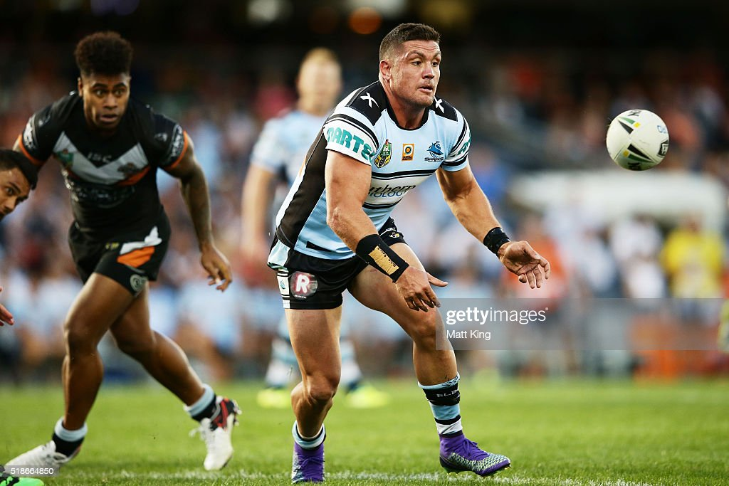 Chris Heighington of the Sharks passes during the round five NRL match between the Wests Tigers and the Cronulla Sharks at Campbelltown Sports Stadium on April 2, 2016 in Sydney, Australia.