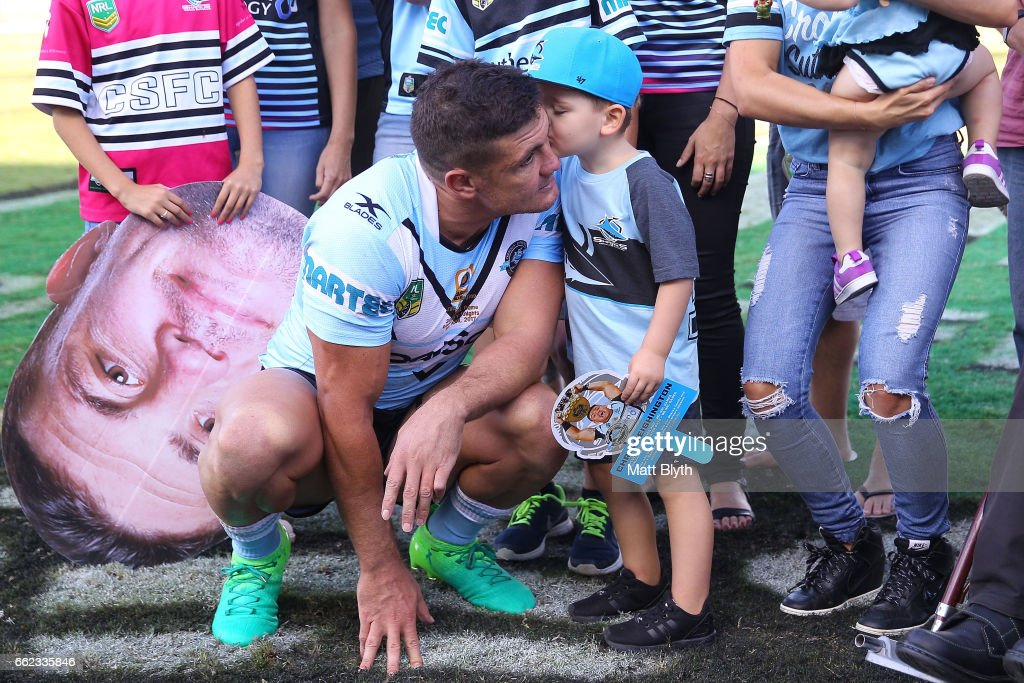 Chris Heighington of the Sharks poses with familty and friends following his 300th first grade match during the round five NRL match between the Cronulla Sharks and the Newcastle Knights at Southern Cross Group Stadium on April 1, 2017 in Sydney, Australia.