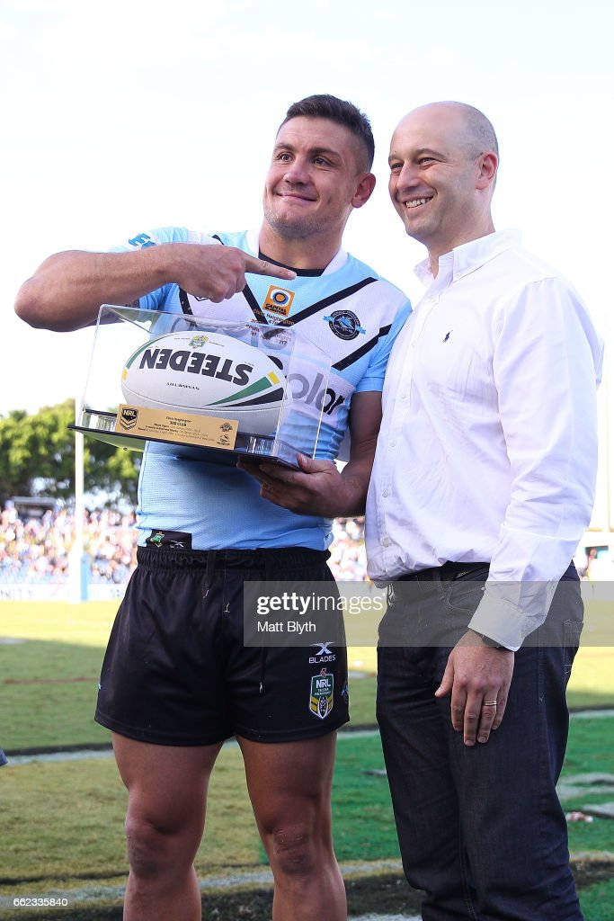 Chris Heighington of the Sharks poses with NRL CEO Todd Greenberg following his 300th first grade match during the round five NRL match between the Cronulla Sharks and the Newcastle Knights at Southern Cross Group Stadium on April 1, 2017 in Sydney, Australia.