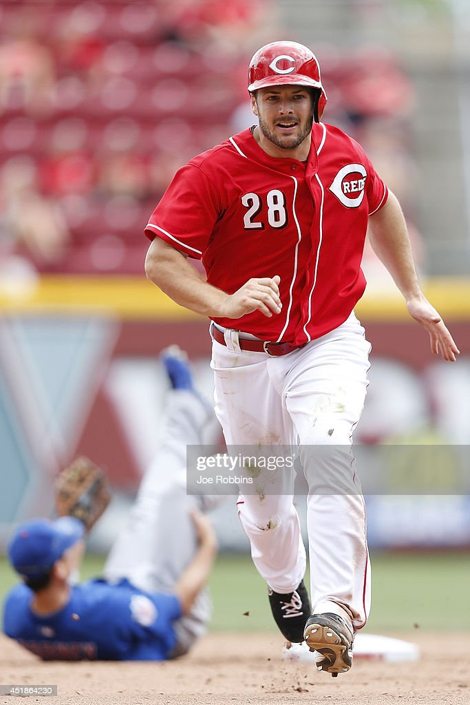 Chris Heisey #28 of the Cincinnati Reds advances to third on an error after stealing second base in the sixth inning of the game against the Chicago Cubs at Great American Ball Park on July 8, 2014 in Cincinnati, Ohio. The Reds won 4-2.