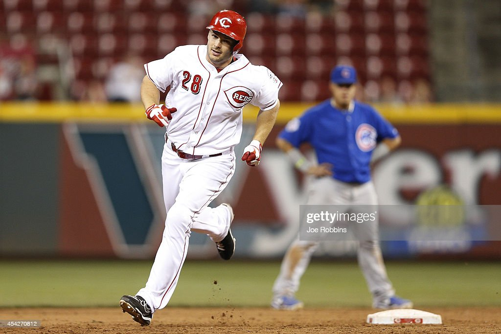 Chris Heisey #28 of the Cincinnati Reds circles the bases after hitting a home run in the eighth inning of the game against the Chicago Cubs at Great American Ball Park on August 27, 2014 in Cincinnati, Ohio. The Reds won 7-5.