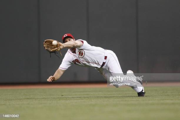 Chris Heisey of the Cincinnati Reds makes the diving catch in centerfield robbing Prince Fielder of the Detroit Tigers of extra bases during their...