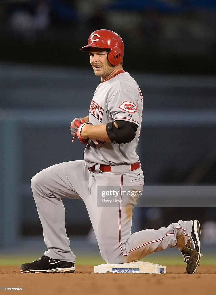 Chris Heisey #28 of the Cincinnati Reds reacts to his double in the fourth inning against the Los Angeles Dodgers at Dodger Stadium on July 26, 2013 in Los Angeles, California.
