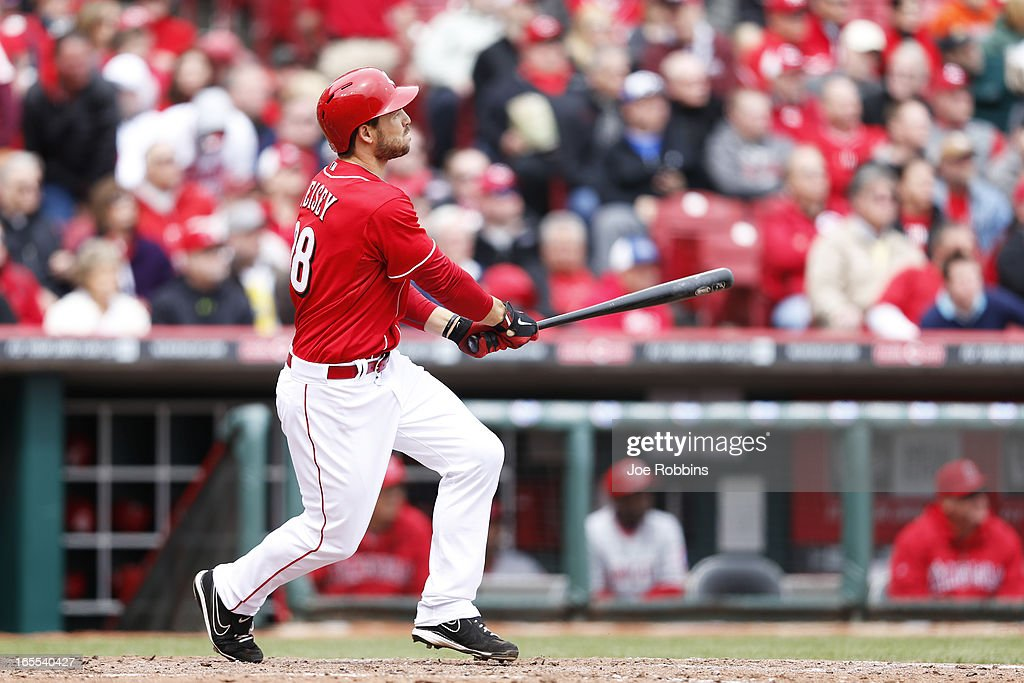Chris Heisey #28 of the Cincinnati Reds watches his two-run homer in the fifth inning of the game against the Los Angeles Angels of Anaheim at Great American Ball Park on April 4, 2013 in Cincinnati, Ohio. The Reds won 5-4.