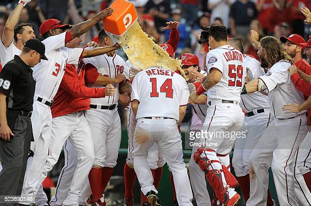 Chris Heisey of the Washington Nationals is doused with sports drink after hitting the gamewinning home run in the 16th inning against the Minnesota...