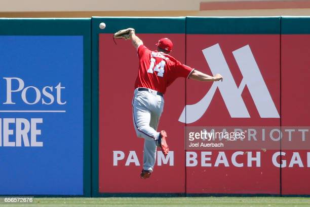 Chris Heisey of the Washington Nationals is unable to catch a ball off the bat of Jhonny Peralta of the St Louis Cardinals for a double in the first...