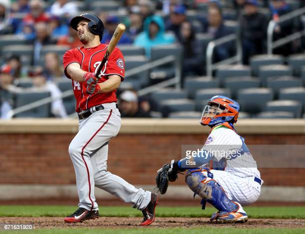 Chris Heisey of the Washington Nationals pinch hits in the eighth inning as Rene Rivera of the New York Mets defends on April 22 2017 at Citi Field...