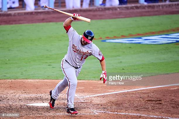 Chris Heisey of the Washington Nationals reacts after flying out in the seventh inning against the Los Angeles Dodgers during game four of the...