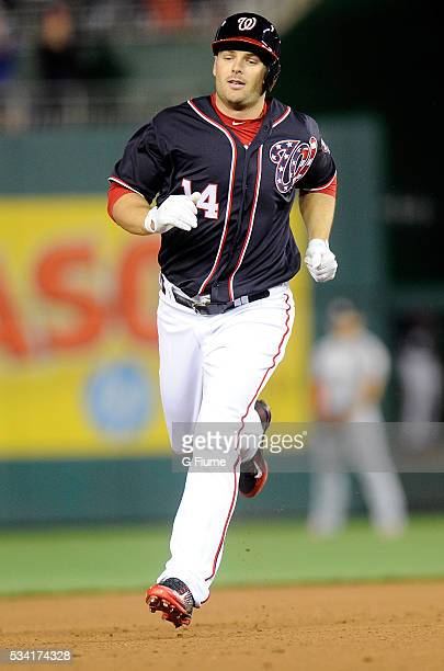 Chris Heisey of the Washington Nationals rounds the bases after hitting a home run against the Miami Marlins at Nationals Park on May 13 2016 in...