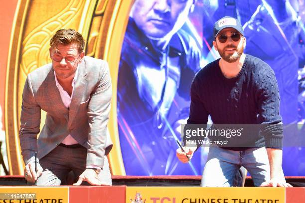 Chris Hemsworth and Chris Evans pose at the Marvel Studios' 'Avengers Endgame' Cast Place Their Hand Prints In Cement At TCL Chinese Theatre IMAX...