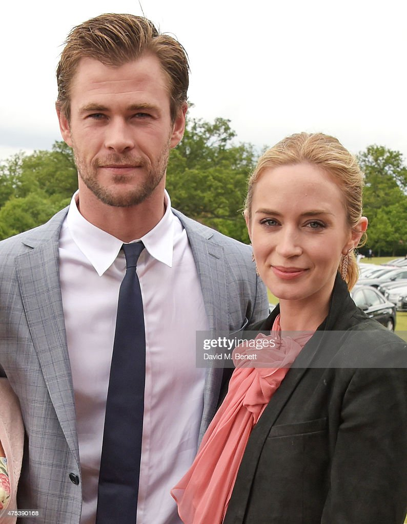 Chris Hemsworth (L) and Emily Blunt attend day two of the Audi Polo Challenge at Coworth Park on May 31, 2015 in London, England.