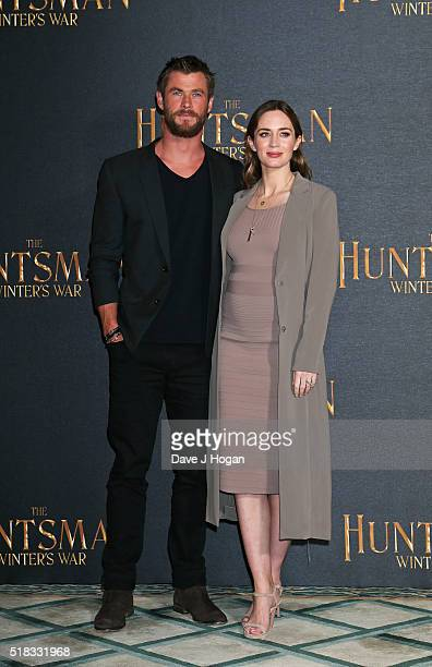 Chris Hemsworth and Emily Blunt attend the photocall for 'The Huntsman Winter's War' at Claridges Hotel on March 31 2016 in London England