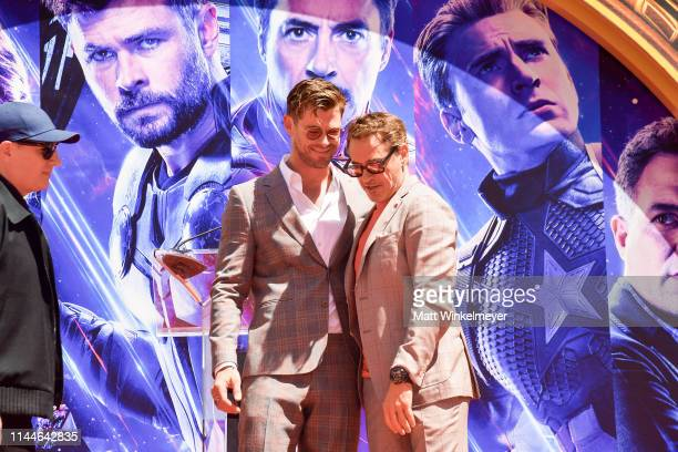 Chris Hemsworth and Robert Downey Jr. Pose at the Marvel Studios' 'Avengers: Endgame' Cast Place Their Hand Prints In Cement At TCL Chinese Theatre...