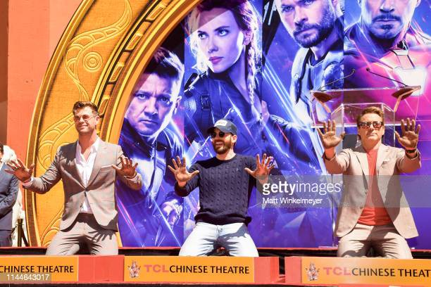 Chris Hemsworth Chris Evans and Robert Downey Jr pose at the Marvel Studios' 'Avengers Endgame' Cast Place Their Hand Prints In Cement At TCL Chinese...