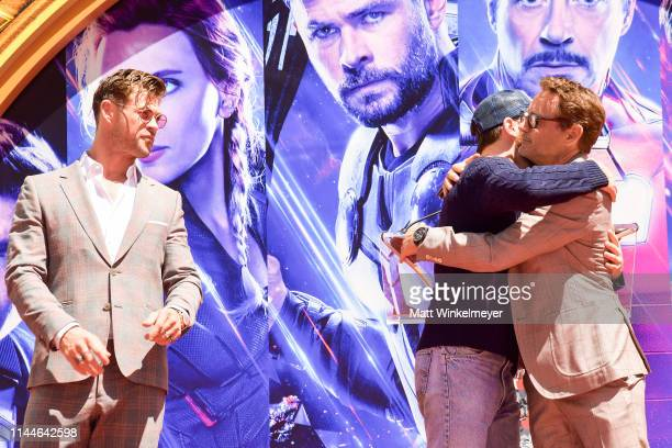 Chris Hemsworth, Chris Evans, Robert Downey Jr. Pose at the Marvel Studios' 'Avengers: Endgame' Cast Place Their Hand Prints In Cement At TCL Chinese...