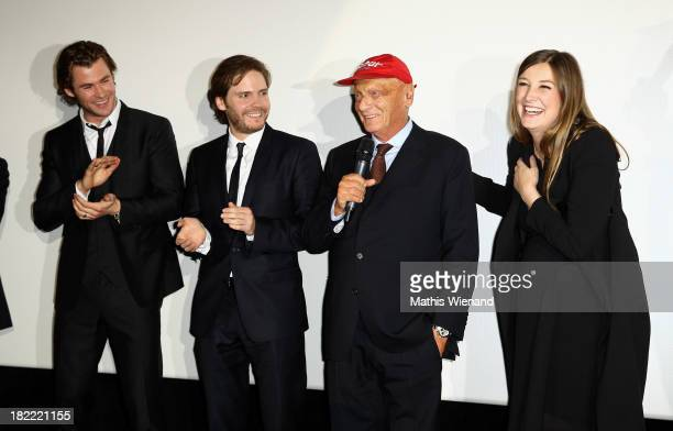 Chris Hemsworth Daniel Bruehl Niki Lauda Alexandra Maria Lara attend the German premiere of the film 'Rush' at Cinedom on September 28 2013 in...