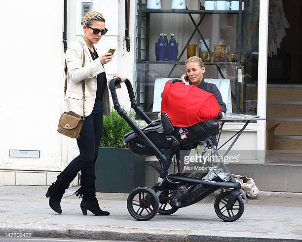 Chris Hemsworth, Elsa Pataky and their daughter India Rose Hemsworth are seen having lunch and house hunting in Notting Hill on June 27, 2012 in...