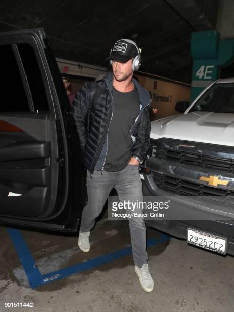 Chris Hemsworth is seen at Los Angeles International Airport on January 05 2018 in Los Angeles California