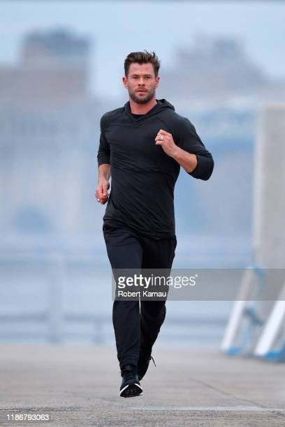 Chris Hemsworth seen in Brooklyn jogging at a photoshoot on December 6, 2019 in New York City.
