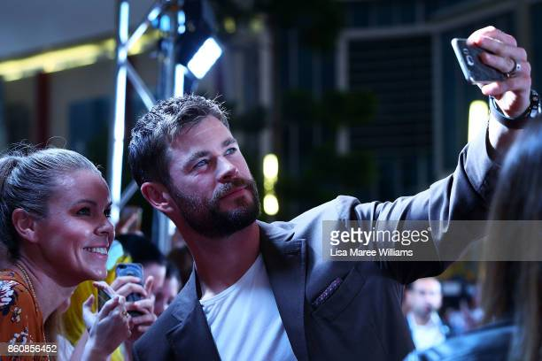 Chris Hemsworth takes photos with fans during the Australian Premiere of Thor Ragnarok on October 13 2017 in Gold Coast Australia