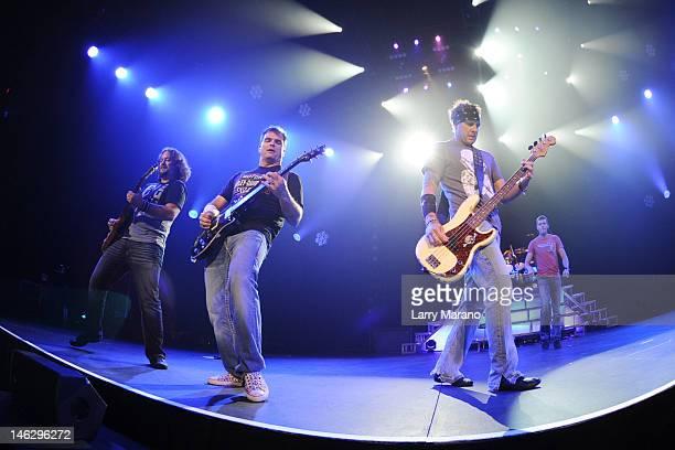 Chris Henderson Matt Roberts Todd Harrell and Brad Arnold of 3 Doors Down perform at Hard Rock Live in the Seminole Hard Rock Hotel Casino on June 12...