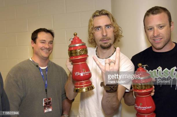 Chris Hendley of the Arena at Gwinnett Center present custom beer steins to Chad Kroeger and Mike Kroeger of Nickelback