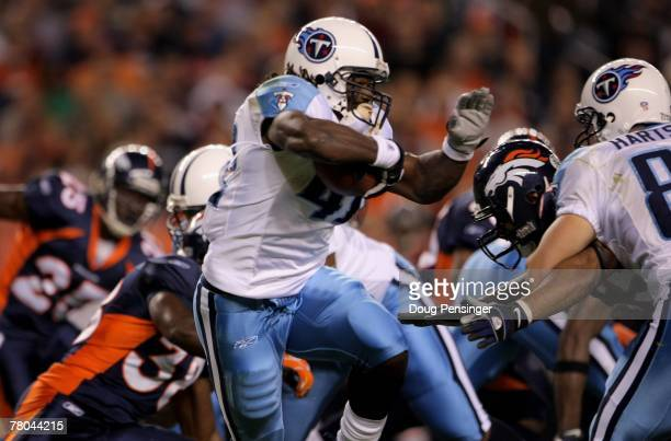 Chris Henry of the Tennessee Titans returns a kick off against the Denver Broncos at Invesco Field at Mile High on November 19 2007 in Denver...