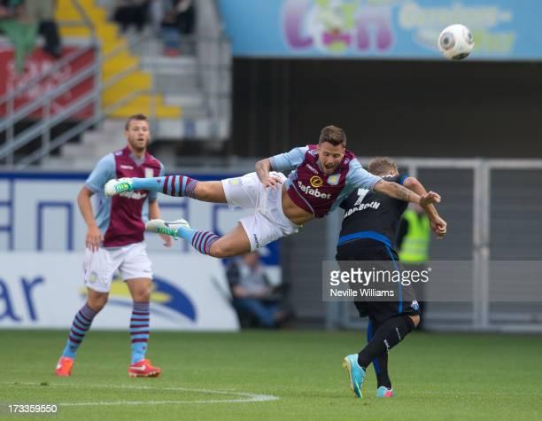Chris Herd of Aston Villa challenges Jens Wemmer of SC Paderborn during the Pre Season Friendly match between SC Paderborn and Aston Villa at...