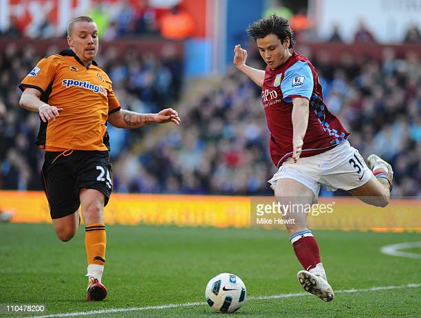 Chris Herd of Aston Villa is challenged by Ronald Zubar of Wolves during the Barclays Premier League match between Aston Villa and Wolverhampton...