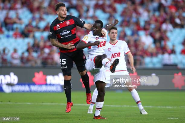 Chris Herd of the Wanderers and Baba Diawara of Adelaide compete for the ball during the round 15 ALeague match between the Western Sydney Wanderers...