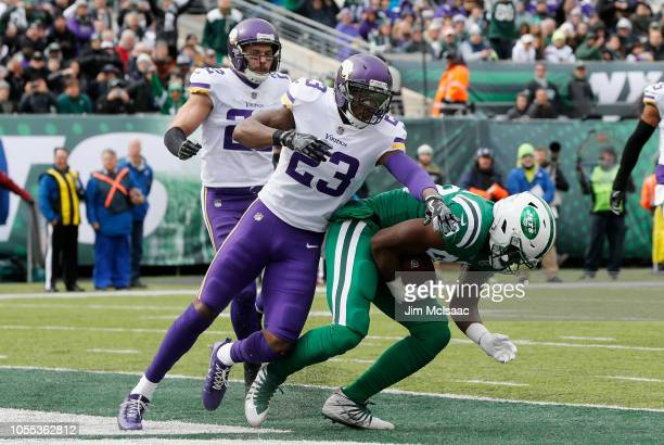 Chris Herndon of the New York Jets touchdown against George Iloka of the Minnesota Vikings on October 21 2018 at MetLife Stadium in East Rutherford...