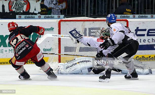 Chris Herperger of Hannover scores over Augsburg'd goalkeeper Dennis Endras his team's 2nd goal during the DEL play off final match between Hannover...