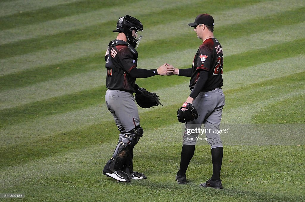 Chris Herrmann #10 and Archie Bradley #25 of the Arizona Diamondbacks celebrate the win against the Colorado Rockies at Coors Field on June 24, 2016 in Denver, Colorado. The Diamondbacks defeat the Rockies 10-9.