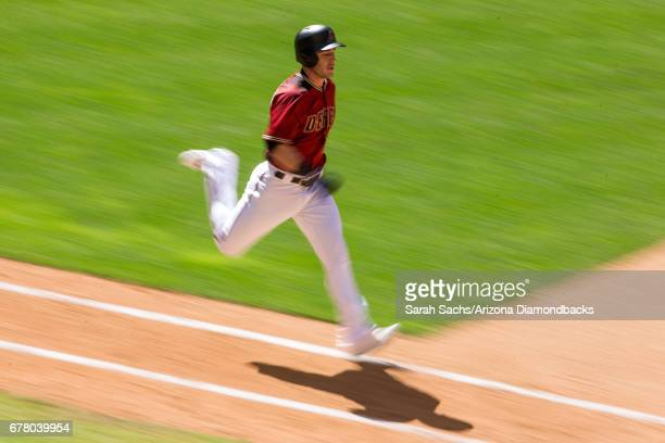 Chris Herrmann of the Arizona Diamondbacks runs down the first base line during a game against the Colorado Rockies on April 30 2017 in Phoenix...