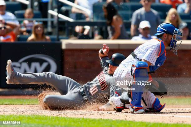 Chris Herrmann of the Arizona Diamondbacks scores past Kevin Plawecki of the New York Mets during the fifth inning on a sacrifice fly at Citi Field...