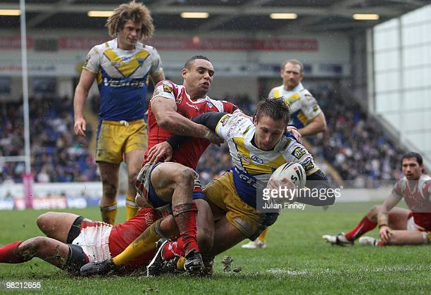 Chris Hicks of Warrington scores a try during the Engage Super League match between Warrington Wolves and Salford City Reds on April 2 2010 in...
