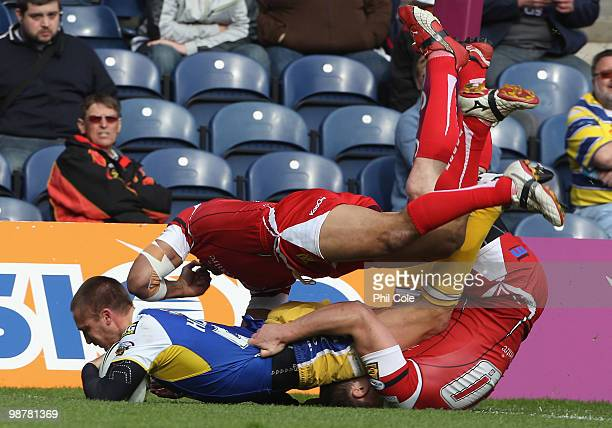Chris Hicks of Warrington Wolves scores a try during the Engage Rugby Super League Magic Weekend match between Salford City Reds and Warrington...