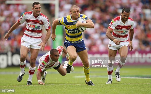 Chris Hicks of Warrington Wolves scores a try during the semifinal match of the Carnegie Challenge Cup between Wigan Warriors and Warrington Wolves...