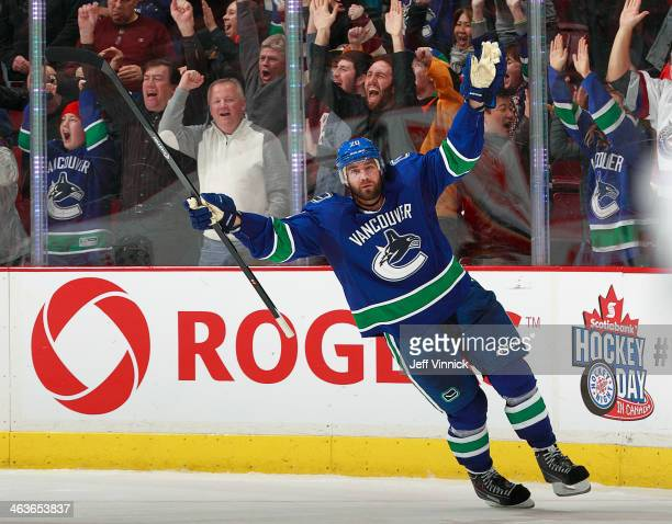 Chris Higgins of the Vancouver Canucks celebrates after scoring the shootout-winning goal against the Calgary Flames in their NHL game at Rogers...