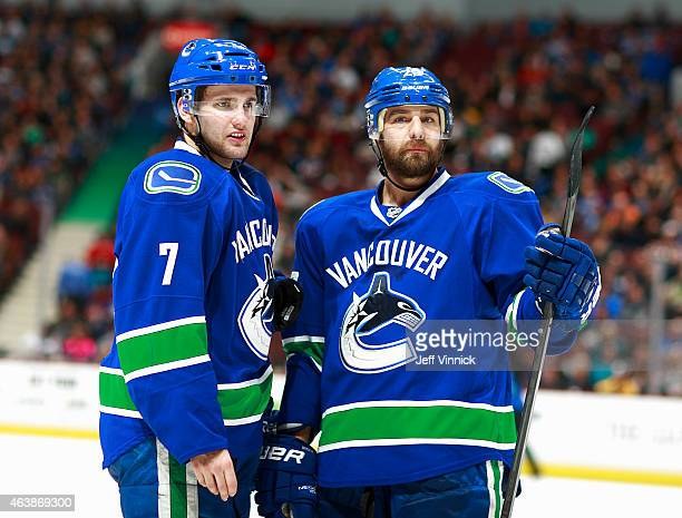 Chris Higgins of the Vancouver Canucks listens to teammate Linden Vey during their NHL game against the Minnesota Wild at Rogers Arena February 16...