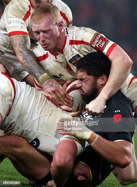 Chris Hill and Liam Farrell of England tackle Jesse Bromwich of New Zealand during the International Rugby League Test Series match between England...